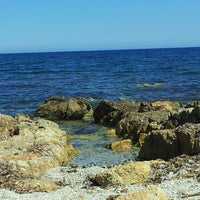 Photo taken at Porto Pirastu by Stefania C. on 6/23/2013