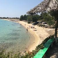 Photo taken at Koviou Beach by Guneyhan . on 6/28/2017