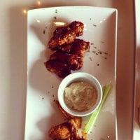 Photo prise au Bluegrass Bar & Grill par Theresia S. le12/15/2012