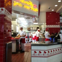 Photo taken at In-N-Out Burger by Ella on 12/23/2012