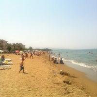 Photo taken at Palmiye Beach by ✌✌☝☝ B. on 7/20/2013