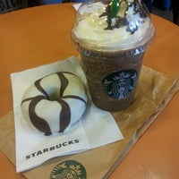 Photo taken at Starbucks Coffee by Candy N. on 3/7/2013