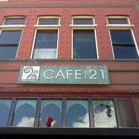 Photo taken at Cafe 21 by Charlotte C. on 1/6/2013