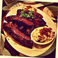 Photo taken at Lucille's Smokehouse Bar-B-Que by Carlos P. on 8/22/2013