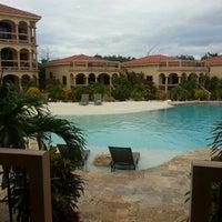 Photo taken at Coco Beach Resort by Matthew C. on 1/21/2013