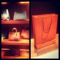 Photo taken at Hermès by Marina V. on 5/15/2013