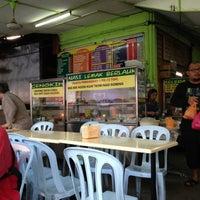 Photo taken at Melawati Food Square by Nik H. on 4/21/2013