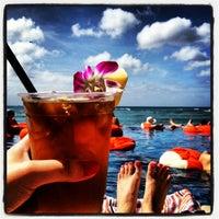 Photo taken at Sheraton Waikiki - The Edge of Waikiki Bar by Caitlin B. on 2/17/2013