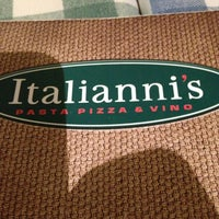 Photo taken at Italianni's Pasta, Pizza & Vino by Manuel L. on 7/14/2013