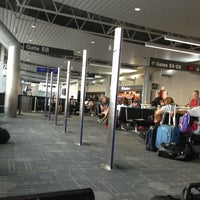 Photo taken at Gate E8 by Amos B. on 7/22/2013