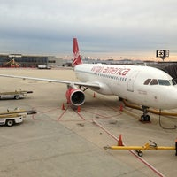 Photo taken at Gate E3 by Andrew K. on 3/18/2013