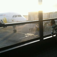 Photo taken at Gate 6 - Aeropuerto El Dorado by Erika M. on 3/31/2013