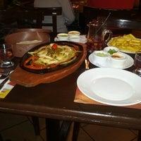 Photo taken at CARAVANA by Juan Manuel H. on 12/23/2012
