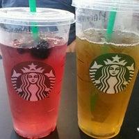 Photo taken at Starbucks by Adriana O. on 8/16/2013