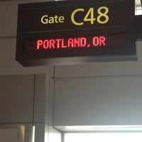 Photo taken at Gate B58 by Julie A. on 1/7/2014
