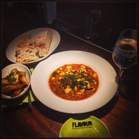 Photo taken at FLAVOUR Weinbar Restaurant by Peter B. on 7/17/2013