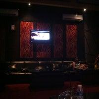 Photo taken at Venus Bar & Karaoke by Rara N. on 1/8/2013