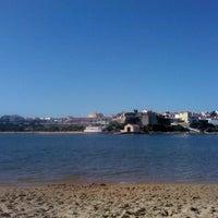 Photo taken at Praia de Vila Nova de Milfontes by André B. on 7/31/2013