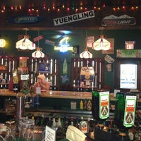 Photo taken at Charlie's Neighborhood Bar & Grill by Corey L. on 3/24/2013
