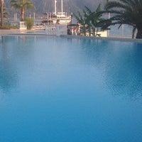 Photo taken at Marmaris Resort Deluxe Pool by Onur Y. on 10/5/2014