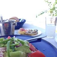Photo taken at NOSTOS Fish Restaurant by Marilou on 9/22/2014