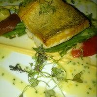 Photo taken at Quatrefoil Restaurant by Cooper W. on 8/10/2013