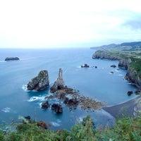 Photo taken at Playa de Pendueles by Manuel R. on 8/13/2013