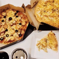 Photo taken at Domino's Pizza by Wan Arief Imran on 7/22/2014