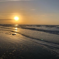 Photo taken at Coligny Beach by Valerie O. on 4/1/2018