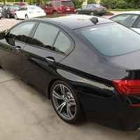 Photo taken at Leith BMW by LeAnn H. on 6/21/2013