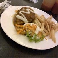 Photo taken at Kafe Betawi by naomie l. on 1/30/2013