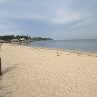 Photo taken at Southold Beach by Jason A. on 8/18/2013