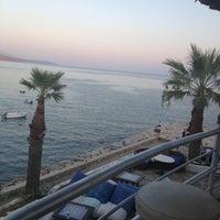 Photo taken at Portofino Hotel & Beach by Öznur K. on 8/10/2013