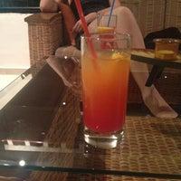 Photo taken at Queen's bay lounge bar by Mariya B. on 7/27/2013