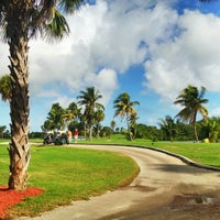 Photo taken at Crandon Golf at Key Biscayne by Alejo T. on 12/8/2012