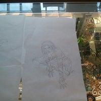 Photo taken at Laughing Buddha Tattoo by Eri C. on 9/22/2012