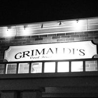 Photo taken at Grimaldi's Coal Brick-Oven Pizzeria by Ryan S. on 2/3/2013