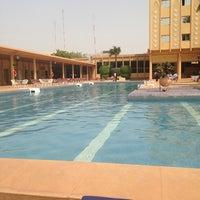Photo taken at Azalai Hotel Independance Ouagadougou by Nil T. on 3/16/2014