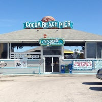 Photo taken at Cocoa Beach Pier by Amber Y. on 1/16/2013
