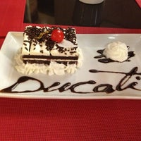 Photo taken at Ducati Caffe by Lubna A. on 9/21/2013