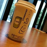 Photo taken at Starbucks by Hiro I. on 7/13/2015