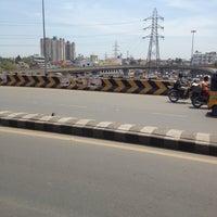 Photo taken at koyambedu signal by Anand I. on 3/8/2013