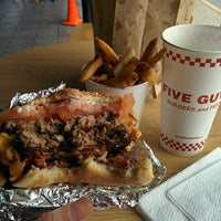 Photo taken at Five Guys by Marlus M. on 3/18/2014