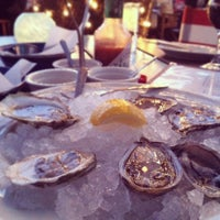 Photo taken at Perla's Seafood and Oyster Bar by Judy T. on 3/12/2013