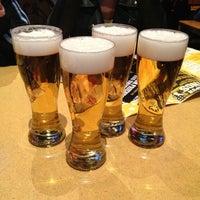 Photo taken at Buffalo Wild Wings Grill & Bar by Jennifer M. on 3/20/2013