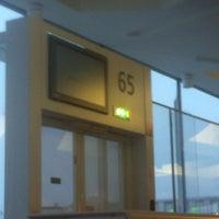 Photo taken at Gate 65 by Thomas B. on 2/23/2013