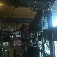 Photo taken at Mangy Moose Restaurant and Saloon by A'yen T. on 3/24/2013