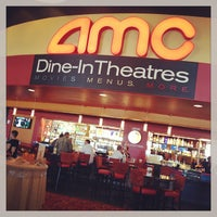 Photo taken at AMC Dine-in Theatres Esplanade 14 by MoniQue on 12/28/2012