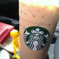 Photo taken at Starbucks by Moses M. on 12/10/2011