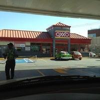 Photo taken at OXXO Gas by Eduardo C. on 1/26/2012